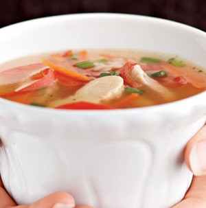 Bowl of soup with chicken, broth and peppers