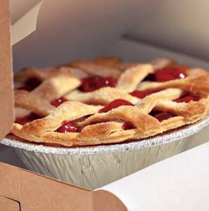 Aluminum pie plate filled with cherry pie with lattice top