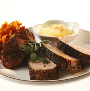Plate of Pork Tenderloin served with Sweet Potato and Applesauce