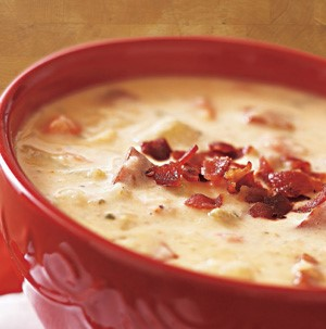 Bowl of Cheesy Potato Soup garnished with Bacon Bits