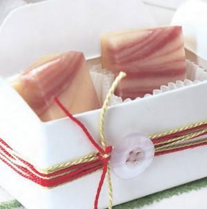 White gift box with white chocolate fudge swirled with raspberries