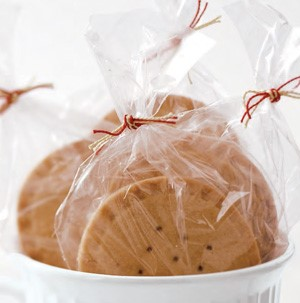 Shortbread cookies wrapped in clear bags and tied with red-and-white string