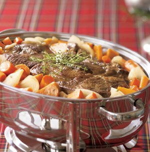 Chafing dish filled with beef pot roast and vegetables
