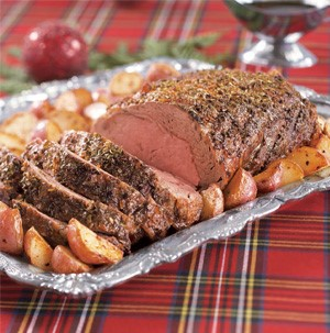 Herb rubbed prime rib with quartered roasted red potatoes on the side