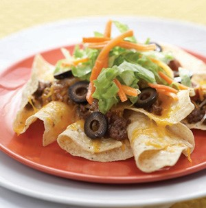 Tortilla Chips topped with Ground Beef, Black Olives, Lettuce and Cheese