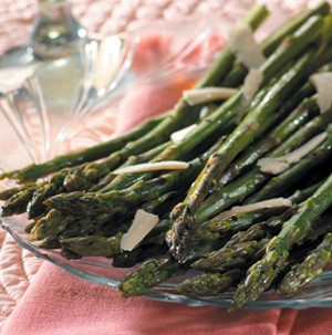 Roasted asparagus on clear glass plate