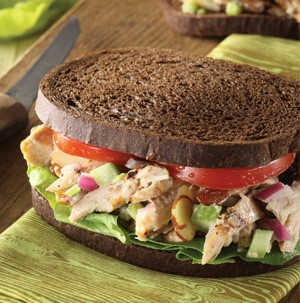 Chicken Almond Salad sandwiched between two slices of Pumpernickel