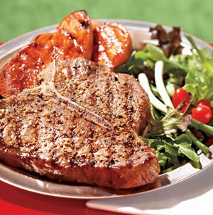 Grilled steak with mixed salad as a side