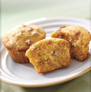 Two pumpkin muffins served on a plate