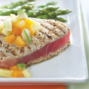 Sesame crusted grilled tuna steaks topped with diced tropical fruits and diced avocado