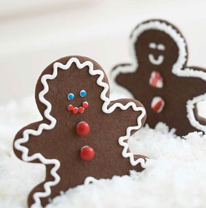 Chocolate Gingerbread Cookies decorated with White Icing and Candy