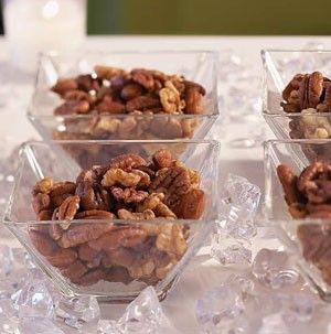 Square glass bowls filled with roasted mixed nuts