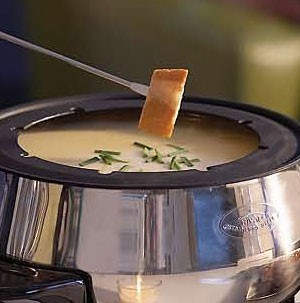 Cubed Bread dipped into Cheese Fondue