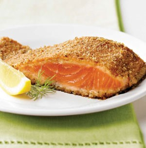 Salmon fillet with a lemon wedge and sprig of dill