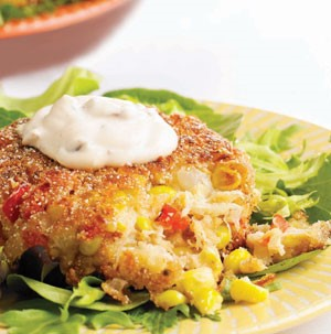 Corn-Crab Cakes topped with Chipotle Cream on a bed of Lettuce