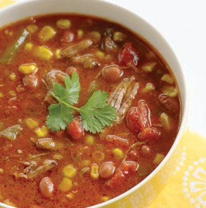 Bowl of beef tortilla soup garnished with cilantro