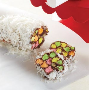 Platter of Chocolate Marshmallow Log Candies covered in Coconut Flakes