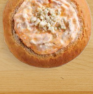 Bread bowl filled with buffalo blue cheese chicken dip