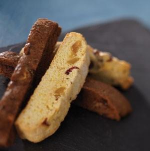 Vanilla and dried fruit biscotti next to chocolate biscotti