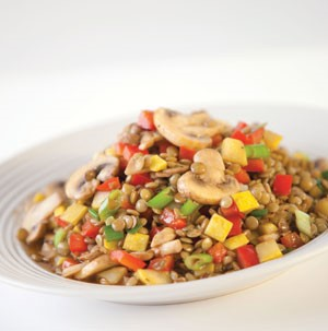Lentils opped with mushrooms and sliced vegetables