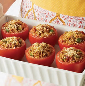 Tray of tomatoes stuffed with bacon and rice