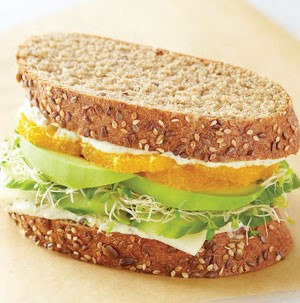 Provolone, Cucumber, Sprouts, Avocado and Oranges sandwiched between Honey, Grain and Seed Bread