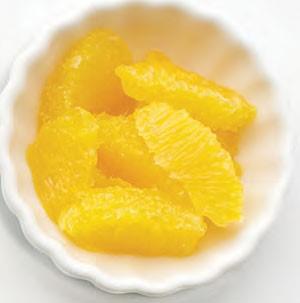 Orange segments in white dish