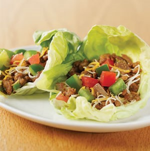 Lettuce leaves stuffed with ground meat, diced peppers, and shredded cheese