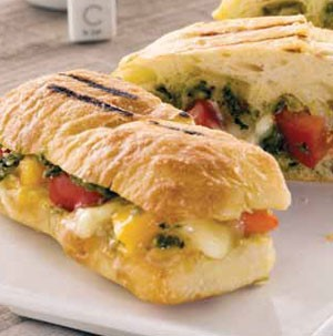 Grilled rolls filled with pesto, tomatoes, and cheese