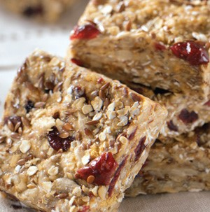 Oat and chia seed stacked square bars packed with dried fruit and sunflower seeds