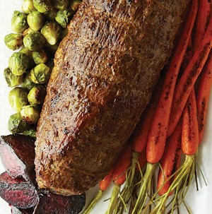 Round Roast next to roasted Brussels Sprouts, Carrots and Beets