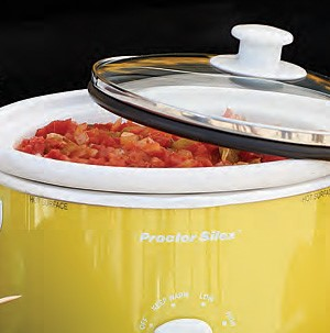 Yellow slow cooker filled with marinara sauce