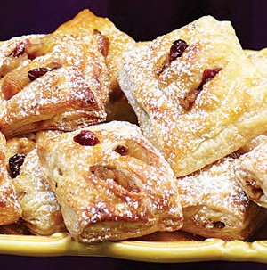 Yellow platter filled with dried fruit strudel minis