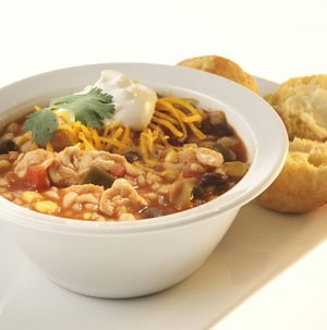 Bowl of Chicken Chili garnished with Cilantro, Cheese and Sour Cream
