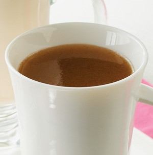 Hot buttered rum in white mug