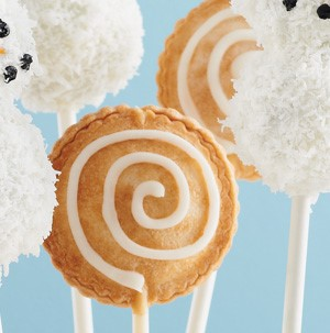 Pie-shaped cake pops with white frosting swirl