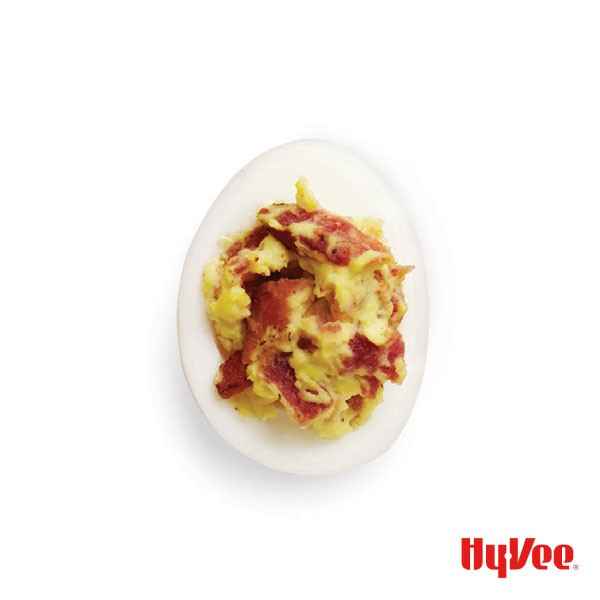 Hard boiled egg filled with deviled eggs and bacon