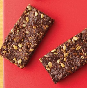 Dried fruit and nut bars on a red background