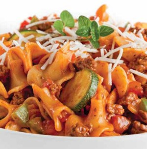 Red sauce covered lasagna noodles, sliced zucchini, ground beef, diced green peppers, garnished with fresh cheese