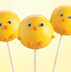 Cake pops on a stick with sprinkles to look like baby chicks