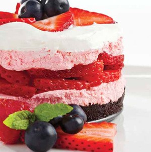 Chocolate-Oreo crust layered with strawberry-flavored cream cheese filling, fresh strawberries and whipped topping