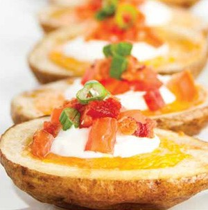 Potato halves filled with cheese, sour cream, chopped bacon and thinly sliced chives