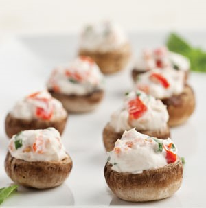 Baby bella mushrooms stuffed with a cream cheese mixture of red pepper, green onion and dill