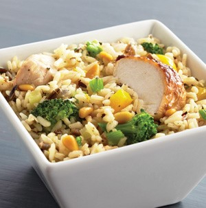 White square bowl of chicken and broccoli rice pilaf