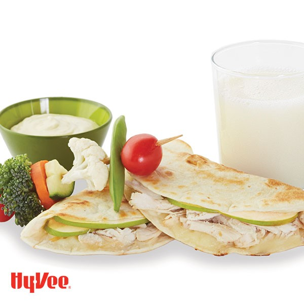 Apple chicken quesadillas next to skewered vegetables and side of dipping sauce