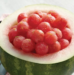 Fresh watermelon balls served in a hollowed watermelon bowl