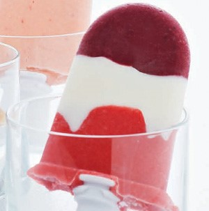 Pink, white and purple berry yogurt pop in a clear glass