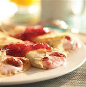 Crepes filled with strawberry cream and topped with strawberry sauce