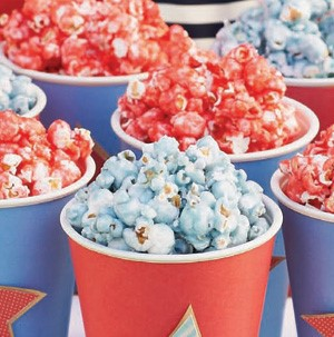Blue and red colored popcorn in red and blue paper cups