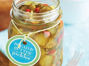 Mason jar filled with bread and butter pickles attached to a homemade label